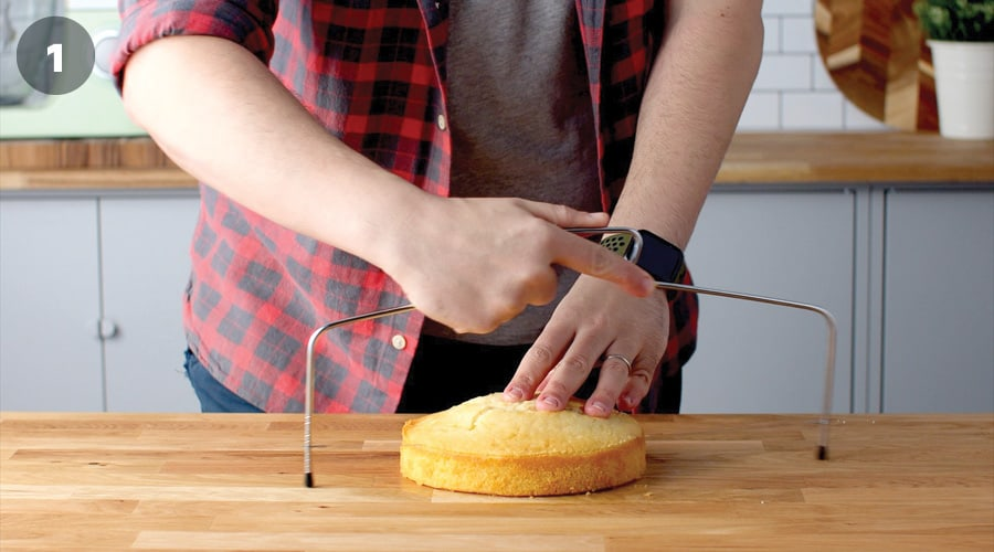 Trimming a cake using cake leveller.