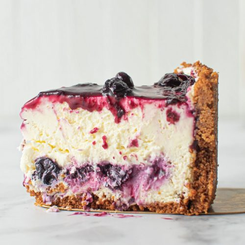 Side shot slice of Blueberry Cheesecake