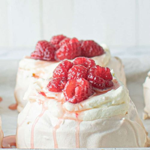 Front shot of Mini Raspberry Pavlovas in baking tray.
