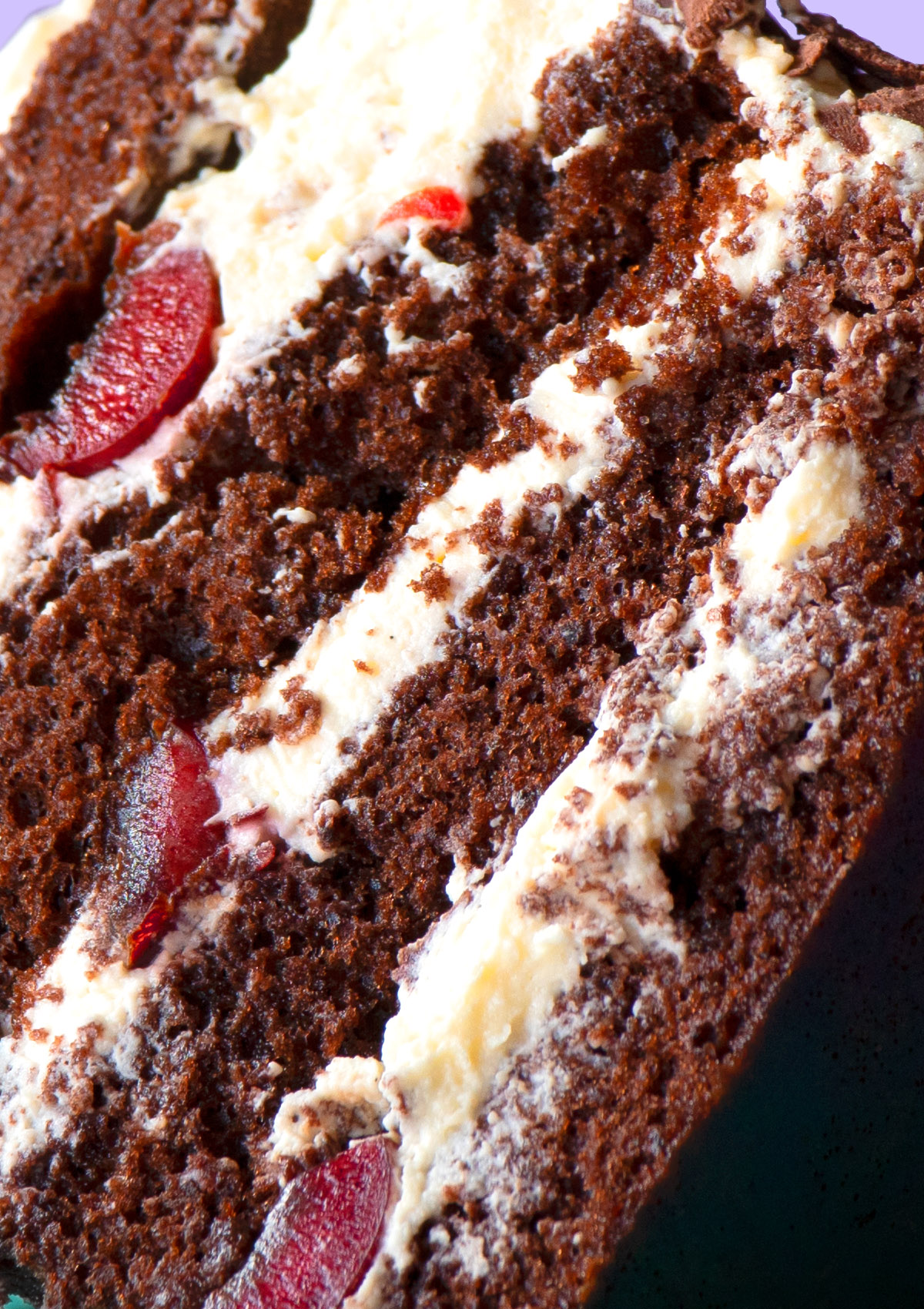 Extreme close up shot of a slice of black forest cake