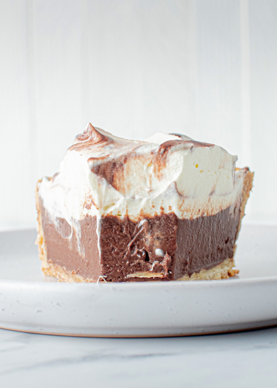 Slice of Indulgent Chocolate Pudding Pie with fork full take out.