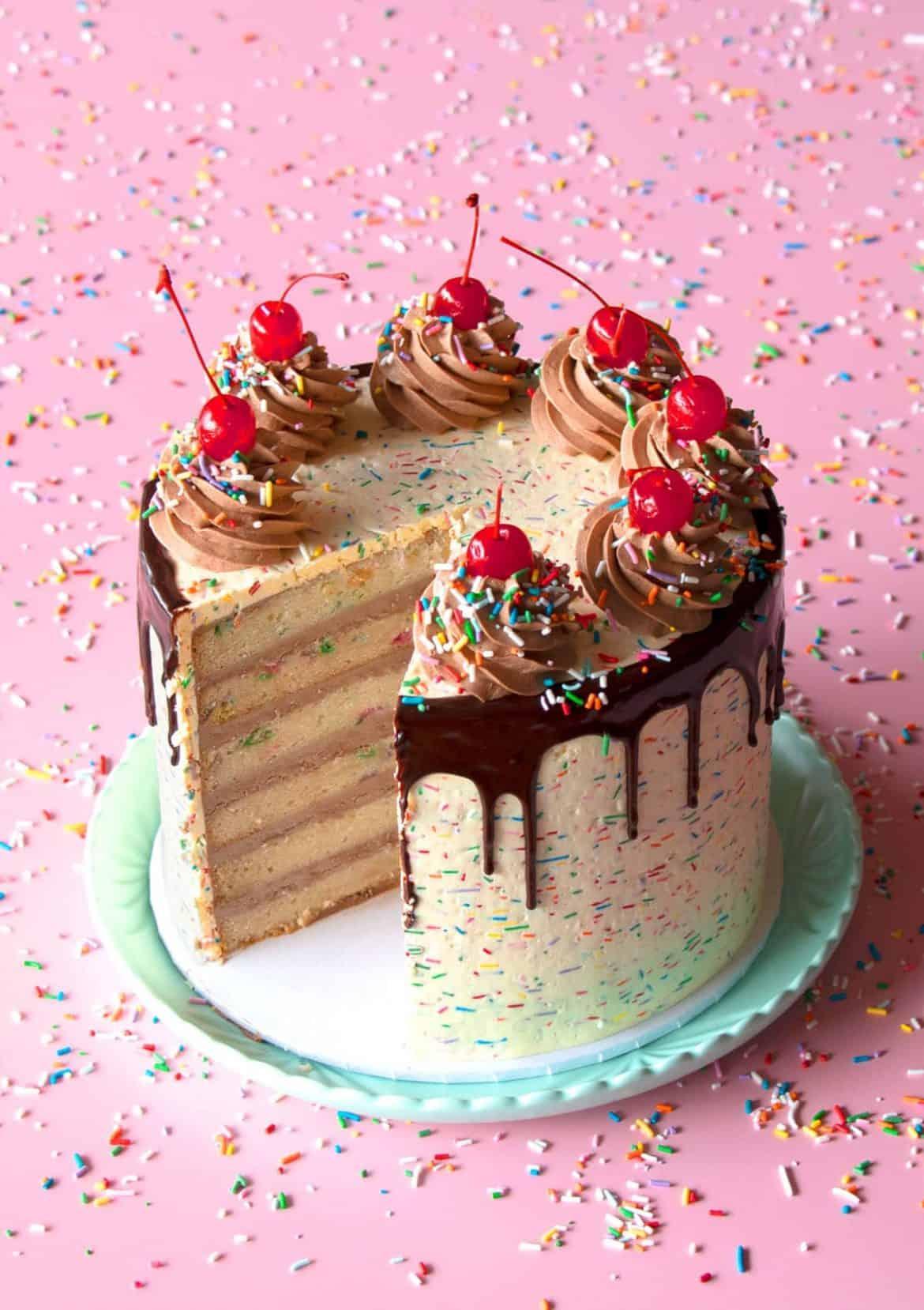 Classic Vanilla Funfetti Cake with slice taken out.