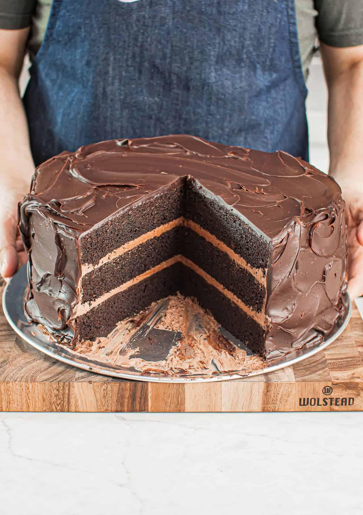 Close up shot of Nick Makrides holding Giant Matilda Cake