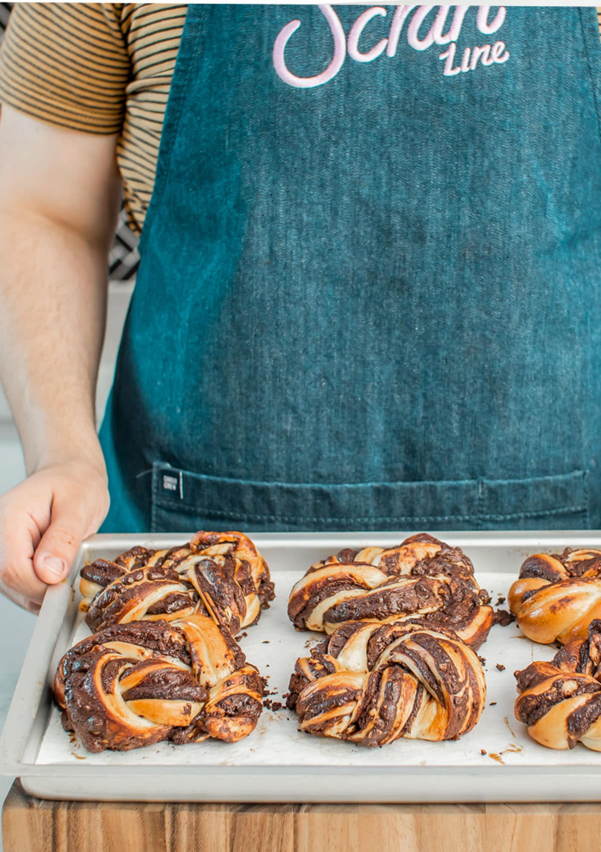 Hazelnut Babka Buns in a baking tray.