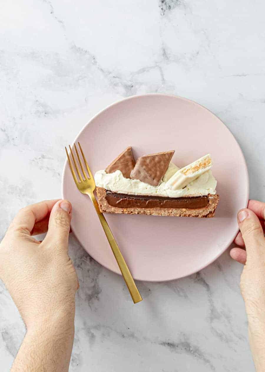 Slice of Tim Tam Tart on a plate