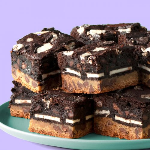 Stack of Slutty Brownies sitting on a plate.