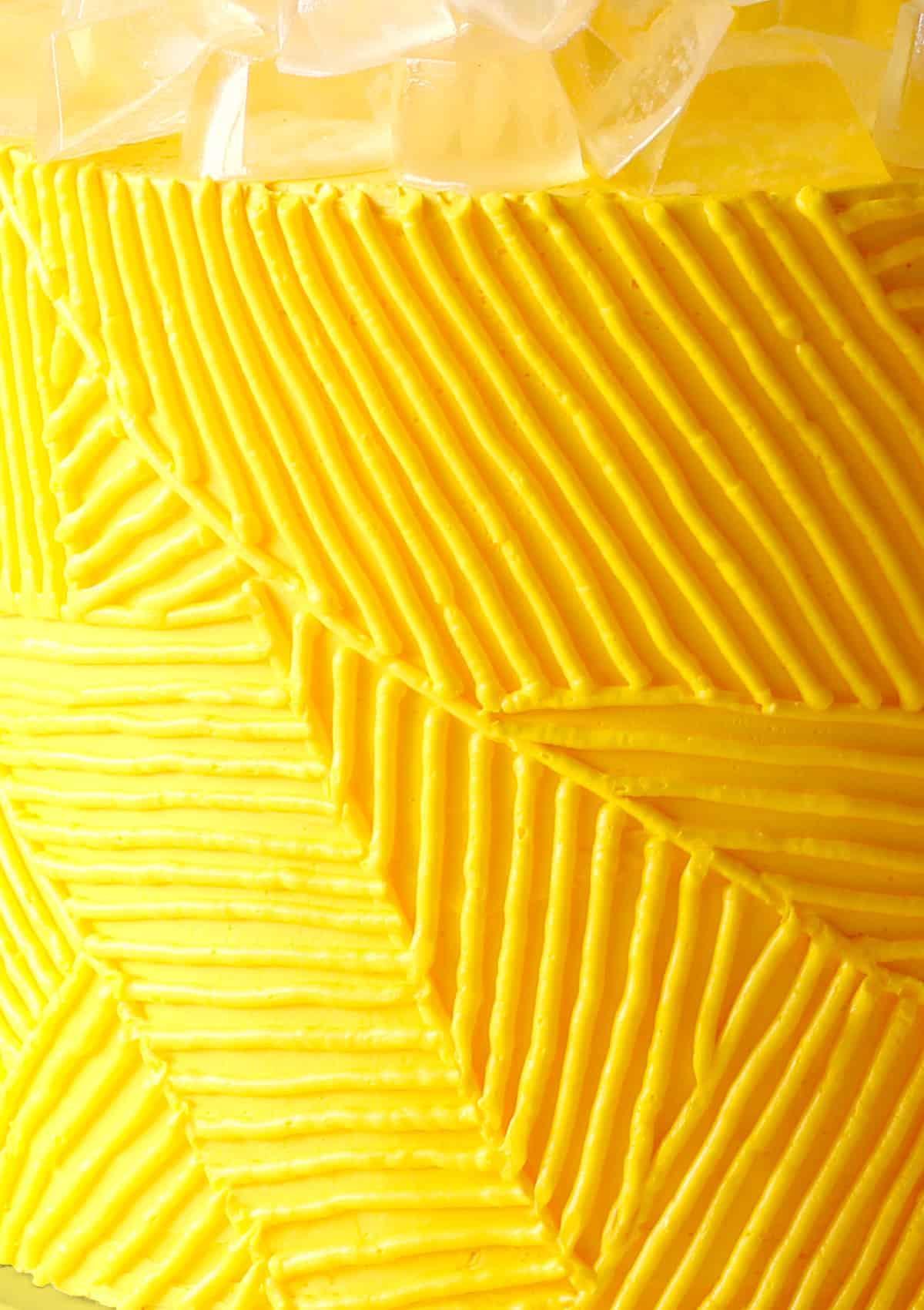 Close up of frosting decoration on Lemonade Cake