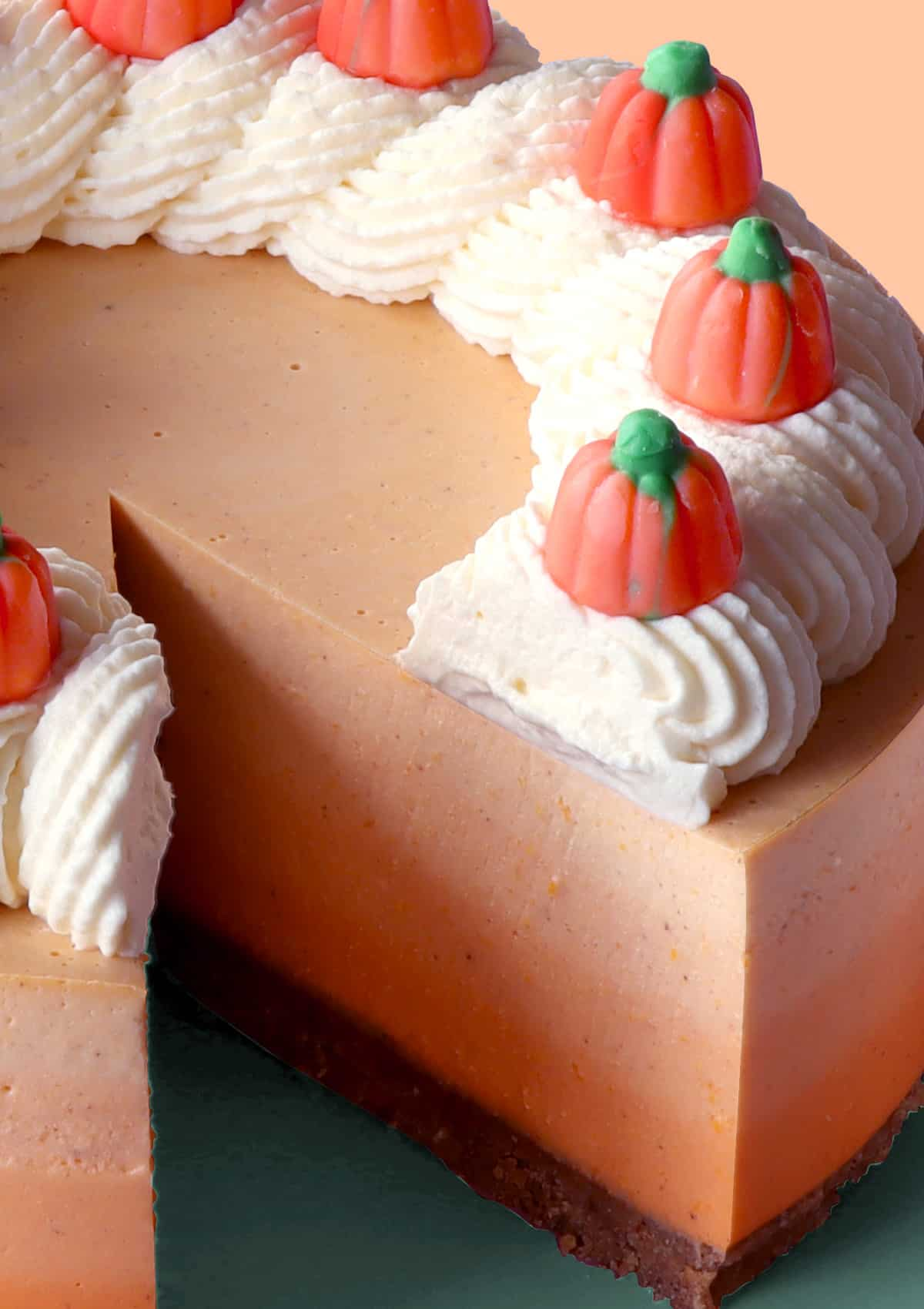 Close up of No-Bake Ombre Pumpkin Cheesecake with slice taken out