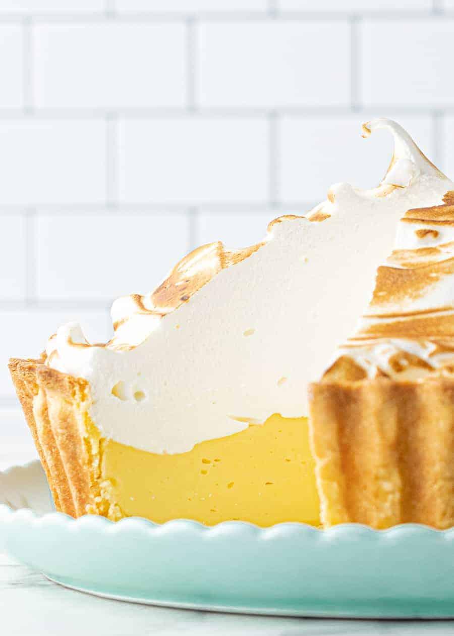 Perfect Lemon Meringue Pie with slice taken out