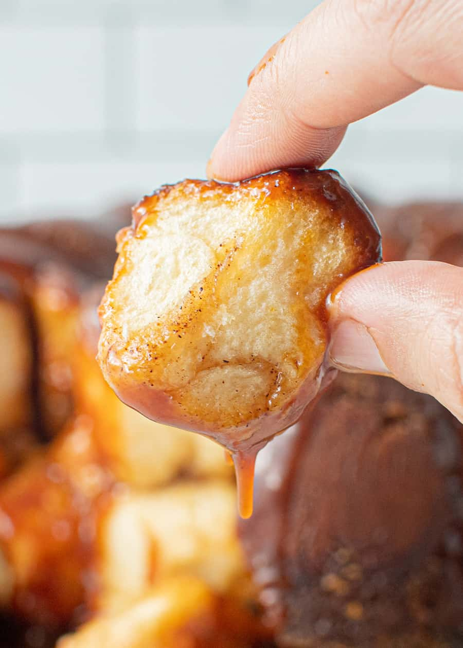 Hand holding a piece of Caramel Monkey Bread