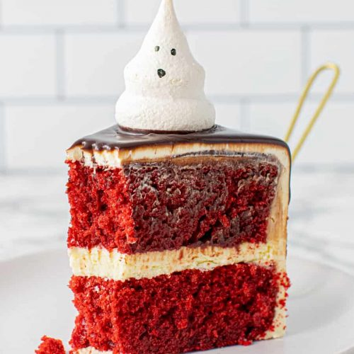 Slice of Meringue Ghost Cake with forkfull taken out
