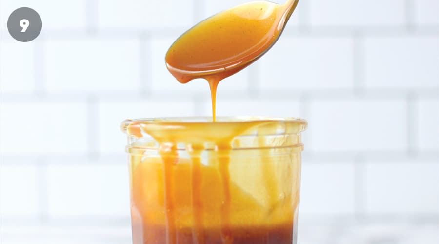 Salted Caramel Sauce dripping off a spoon